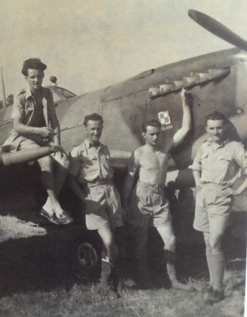 Stefan Knapp sitting on the wing of a RAF Spitfire during World War 2